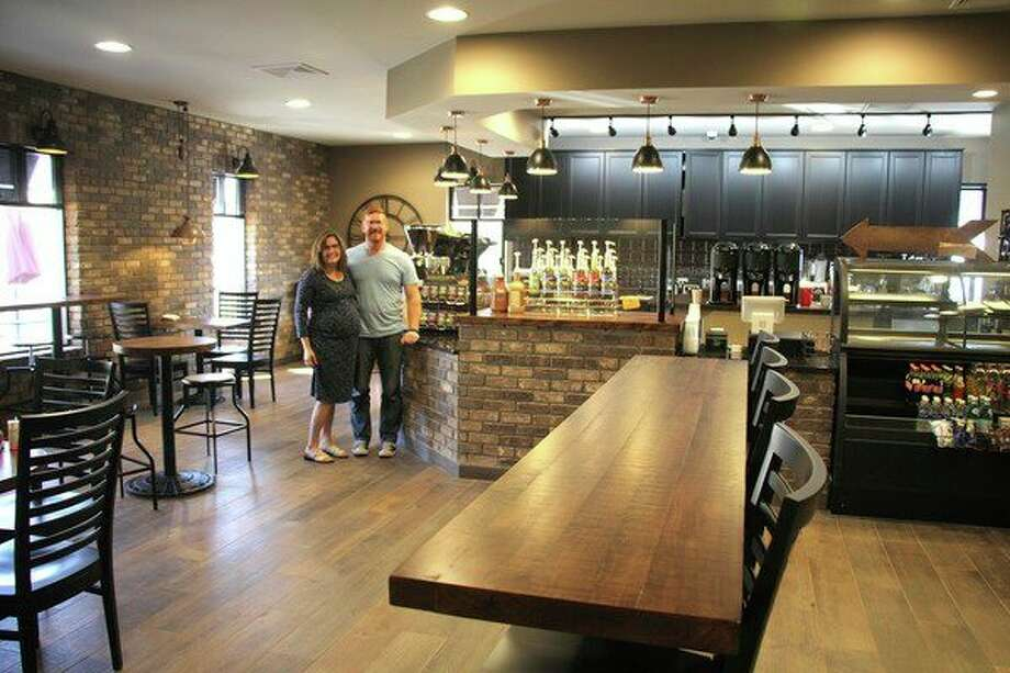 Jessi and Brad Severance stand in Emma's Coffee Shop, which they are readying for opening Oct. 30. (Chip Burch/Huron Daily Tribune)