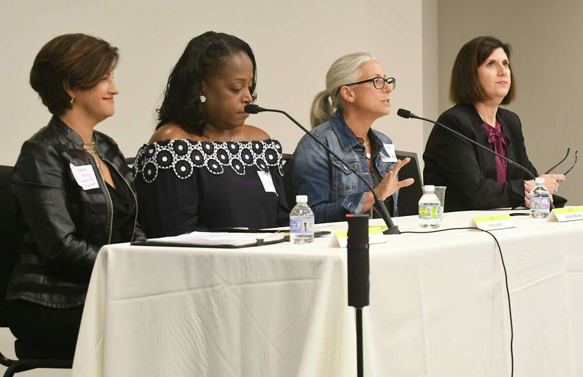 From left, Georgia Kelly, Merrill Lynch Wealth Management, Kymlee Dorsey, STYLE Wellness and Hair Studio, Eve Waltermaurer, Benjamin Center, SUNY New Paltz, and Denise Gonick, MVP Health Care were the panel for a discussion for Women@Work summit follow up at the Hearst Media Center on Thursday, Oct. 5, 2017 in Colonie, N.Y. (Lori Van Buren / Times Union)