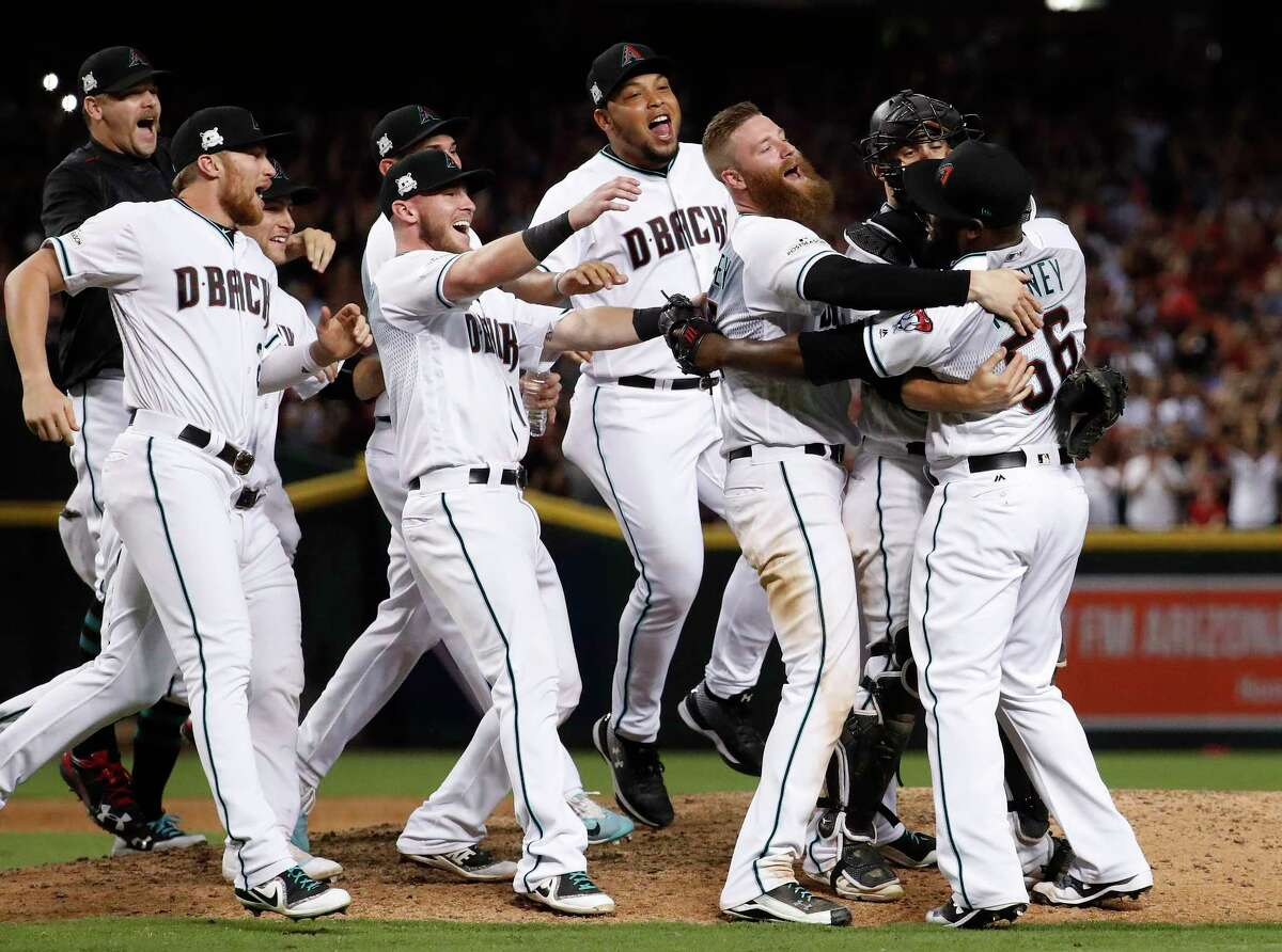 The Arizona Diamondbacks celebrate after the National League wild-card playoff baseball game against the Colorado Rockies, Wednesday, Oct. 4, 2017, in Phoenix. The Diamondbacks won 11-8 to advance to an NLDS against the Los Angeles Dodgers. (AP Photo/Matt York)