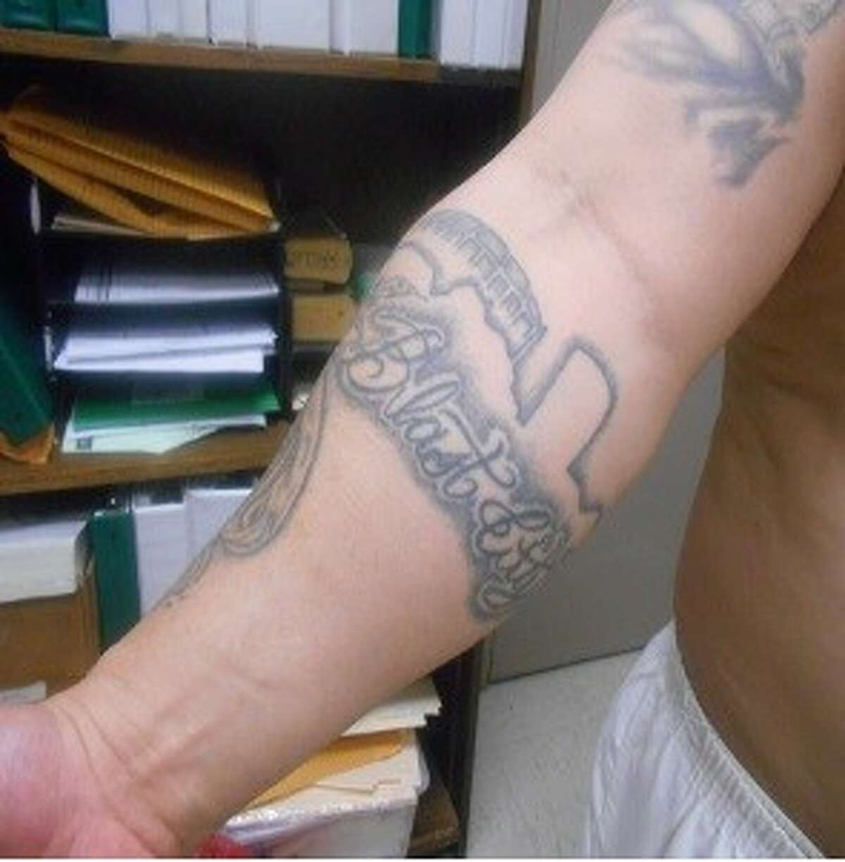 Convicted sex offender and Tango Blast gang member Manuel Mora is wanted by the Texas Attorney General's Office for a parole violation. This photo shows the tattoo on his right arm.PHOTOS: Fugitives sought by Houston-area police
