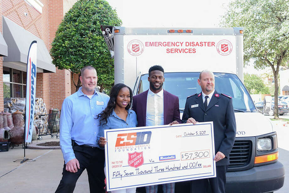 Denver Broncos wide receiver Emmanuel Sanders returned to Houston on Thursday to give back and provide aid to hurricane victims.The Conroe native presented a check through his charitable foundation to the Houston Community ToolBank. Photo: Rochelle Chambers