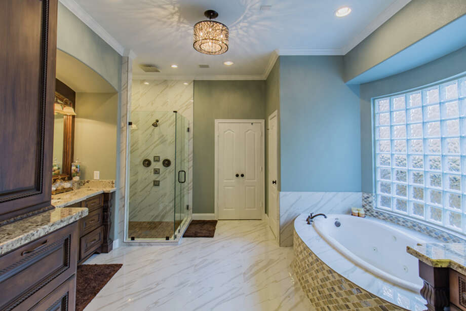 This is a master bath project completed by Caliber Construction Group/Certified Restoration. Photo: Courtesy Of Caliber Construction Group