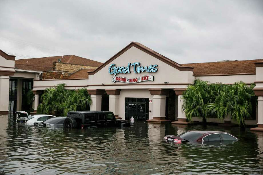 "A restaurant called ""Good Times"" sits in floodwater in Port Arthur on Aug. 30. Hurricanes Harvey and Irma had a detrimental effect on the job market last month. Photo: Marcus Yam /Los Angeles Times / Los Angeles Times"