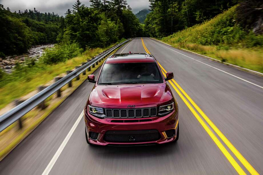 Jeep's muscular SUV has its own ventilated hood. The fog lights are sacrificed so that one opening hides an oil cooler while the other feeds cool air to the powerful V8. Photo: Jeep / Copyright © 2017 FCA US LLC. All Rights Reserved.