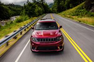 Jeep's muscular SUV has its own ventilated hood. The fog lights are sacrificed so that one opening hides an oil cooler while the other feeds cool air to the powerful V8.