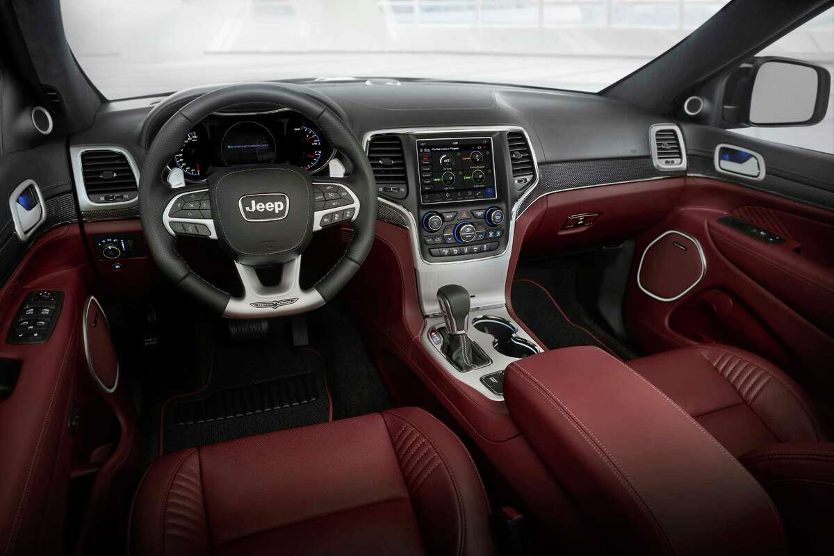 The instrument panel and center stack are dominated by a crisp 8.4-inch touchscreen. A flat-bottomed multi-function steering wheel is standard.