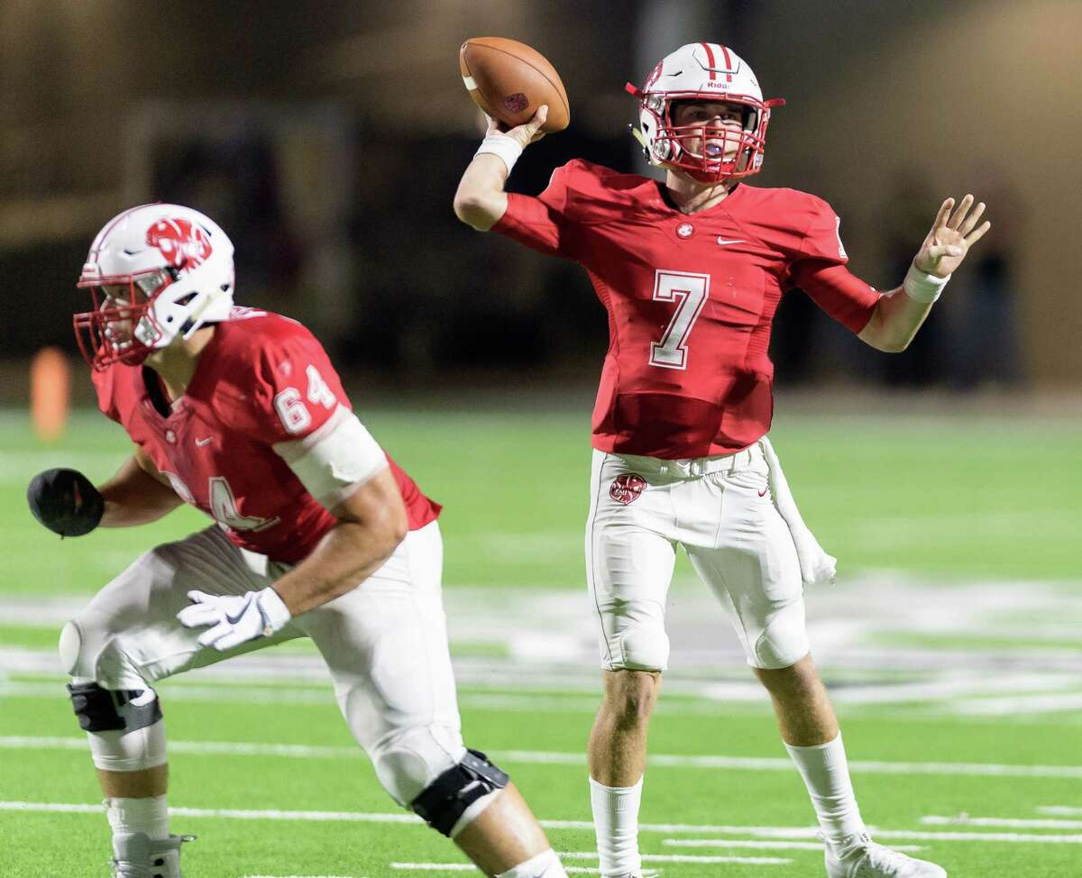 Austin Marshall (7) of the Katy Tigers attempts a pass in the second half against the Cinco Ranch Cougars in a high school football game on Friday, September 22, 2017 at Legacy Stadium in Katy Texas.
