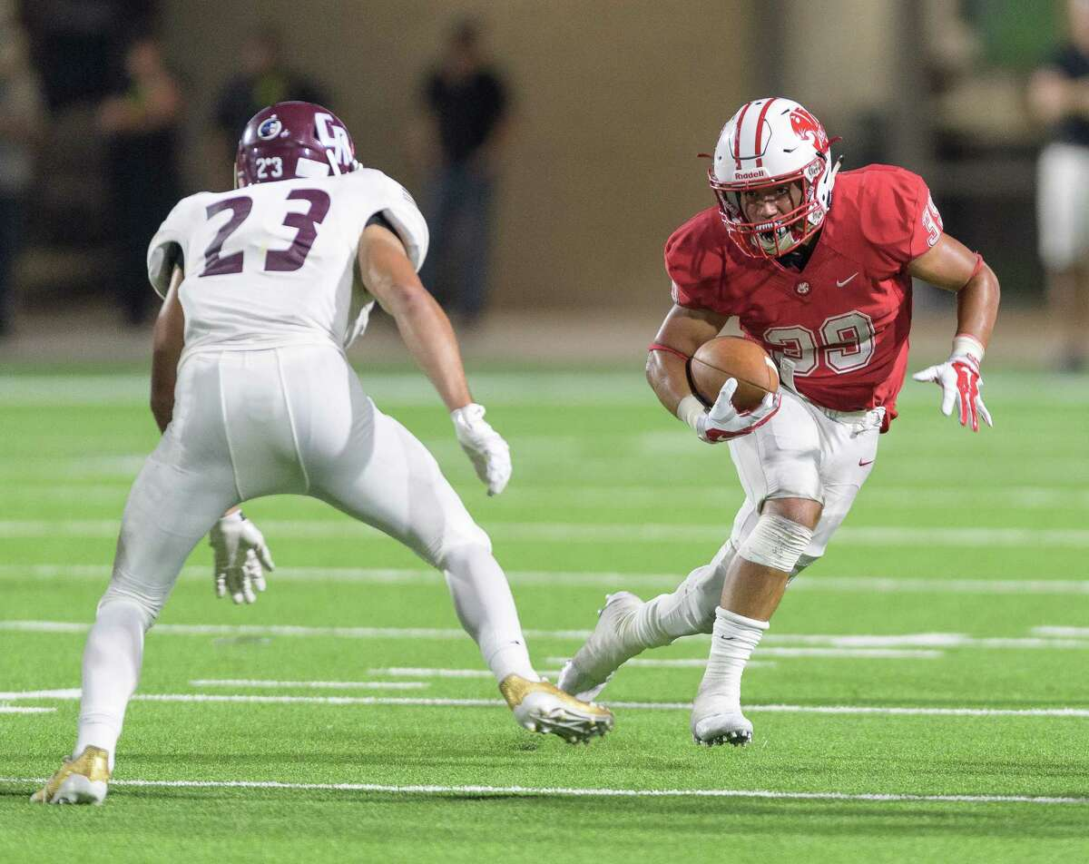 Masen Rivera (39) of the Katy Tigers runs up the middle for a short gain in the second half against Cinco Ranch Cougars in a high school football game on Friday, September 22, 2017 at Legacy Stadium in Katy Texas.