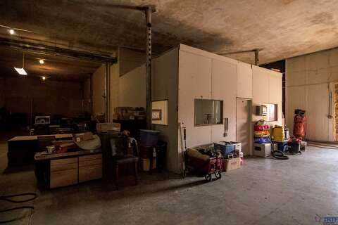 Photos: Inside the abandoned Merchant Ice building, set to ... on nicest ice house, igloo ice house, texans ice house, ice house construction, ice house history, ice house plans, 19th century ice house, old ice house, ice house trailers, ice house roof design, ice water house,