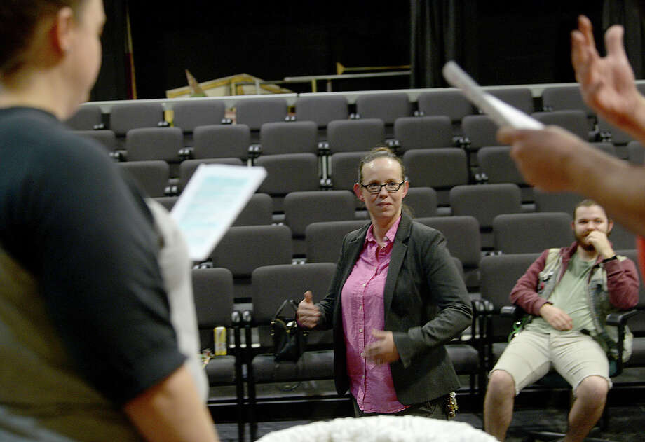 "Beaumont Community Players director Dee Dee Howell works with actors, including Carrie Wilson and Paul Martin as they gather for rehearsal at the Betty Greenberg Center for the Arts Thursday night. Howell is directing the troupe's upcoming production of Christopher Durang's ""Baby with the Bathwater."" Photo taken Thursday, September 28, 2017 Kim Brent/The Enterprise Photo: Kim Brent / BEN"