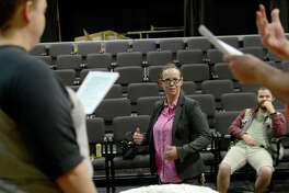 """Beaumont Community Players director Dee Dee Howell works with actors, including Carrie Wilson and Paul Martin as they gather for rehearsal at the Betty Greenberg Center for the Arts Thursday night. Howell is directing the troupe's upcoming production of Christopher Durang's """"Baby with the Bathwater."""" Photo taken Thursday, September 28, 2017 Kim Brent/The Enterprise"""