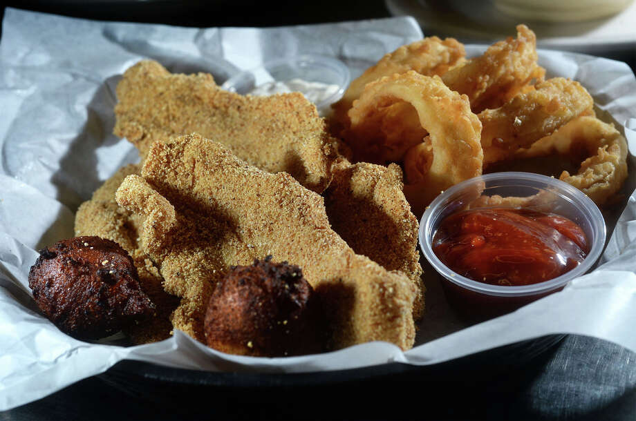 Fried catfish with onion rings and hush puppies at James Brown's Gumbo House and Grill in Vidor. Photo taken Thursday, October 05, 2017 Guiseppe Barranco/The Enterprise Photo: Guiseppe Barranco, Photo Editor / Guiseppe Barranco ©