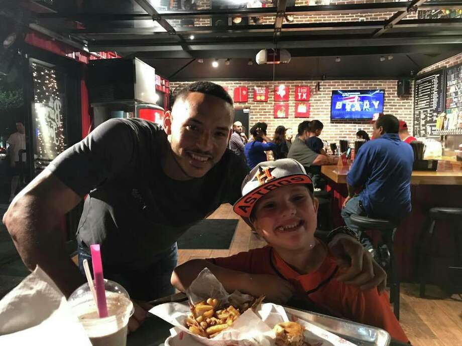 PHOTOS: Carlos Correa at Burger Joint and hanging out with his girlfriend Daniella RodriguezHouston Astros shortstop Carlos Correa had dinner at Burger Joint after Thursday's playoff win over the Red Sox, and he signed autographs for fans.Browse through the photos above for a look at Carlos Correa at Burger Joint and hanging out with his girlfriend Daniella Rodriguez. Photo: Sara Jackson
