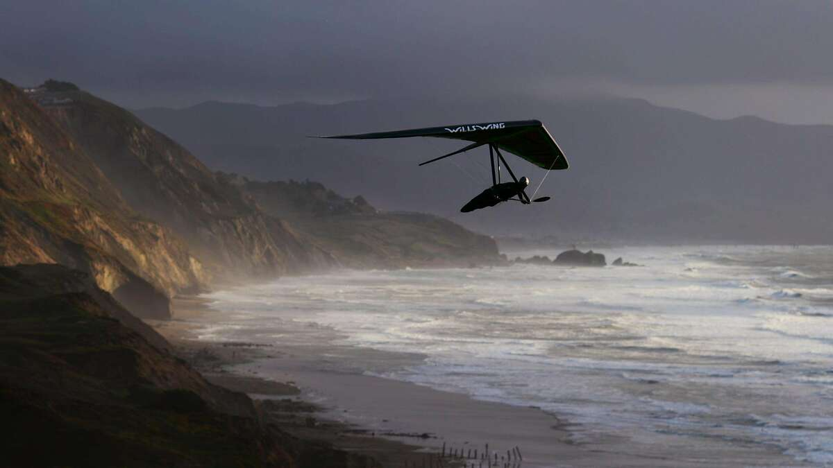 Zac Majors, a six-time U.S. Hang Gliding National Champion, flies over Fort Funston on January 23, 2016. He has been flying at Fort Funston for about 20 years.
