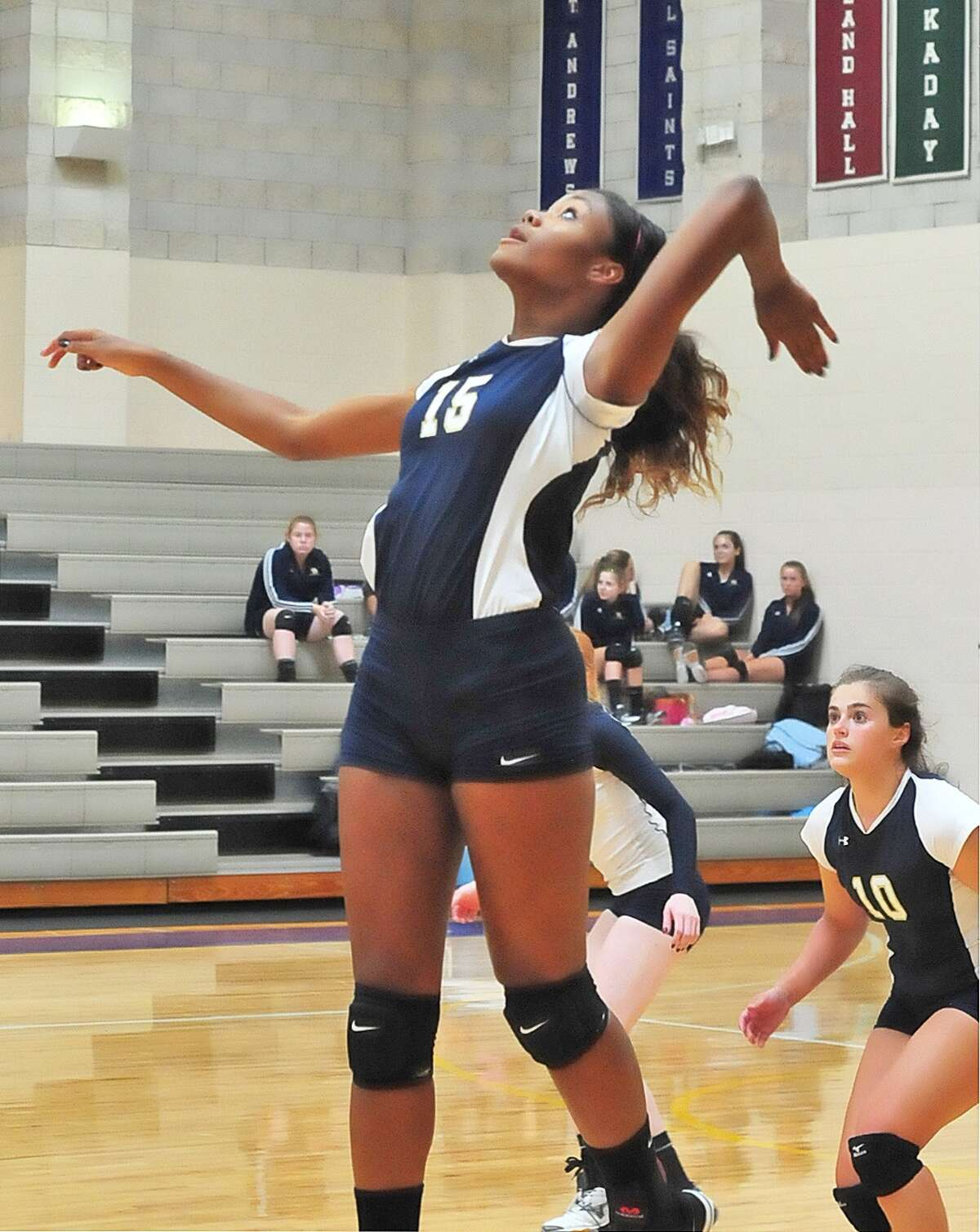 Kelsey Chambers (#15) competes for Second Baptist during their game at Kinkaid Tuesday 8/20/13. At right is Haley Caron (#10).