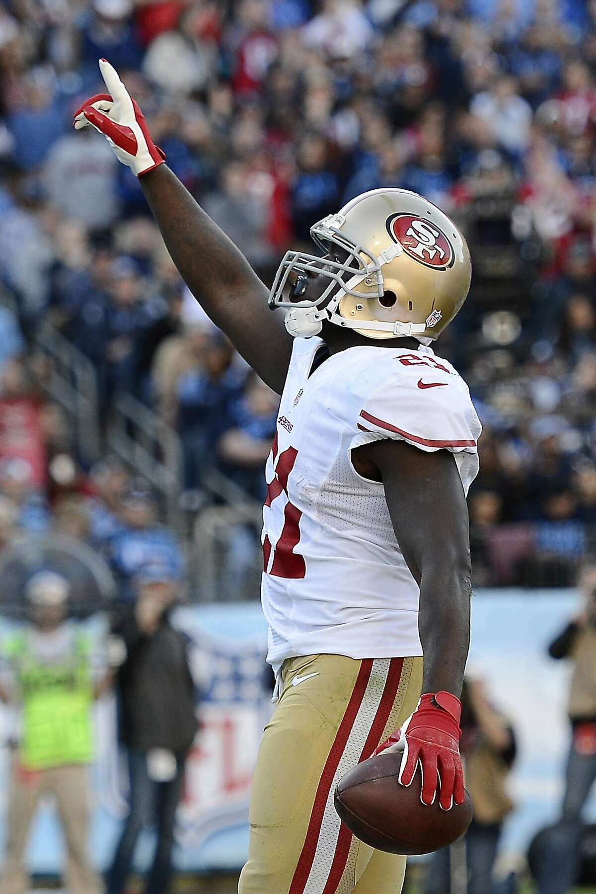 San Francisco 49ers running back Frank Gore celebrates after scoring a touchdown on a 1-yard run against the Tennessee Titans in the second quarter of an NFL football game on Sunday, Oct. 20, 2013, in Nashville, Tenn. (AP Photo/Mark Zaleski)