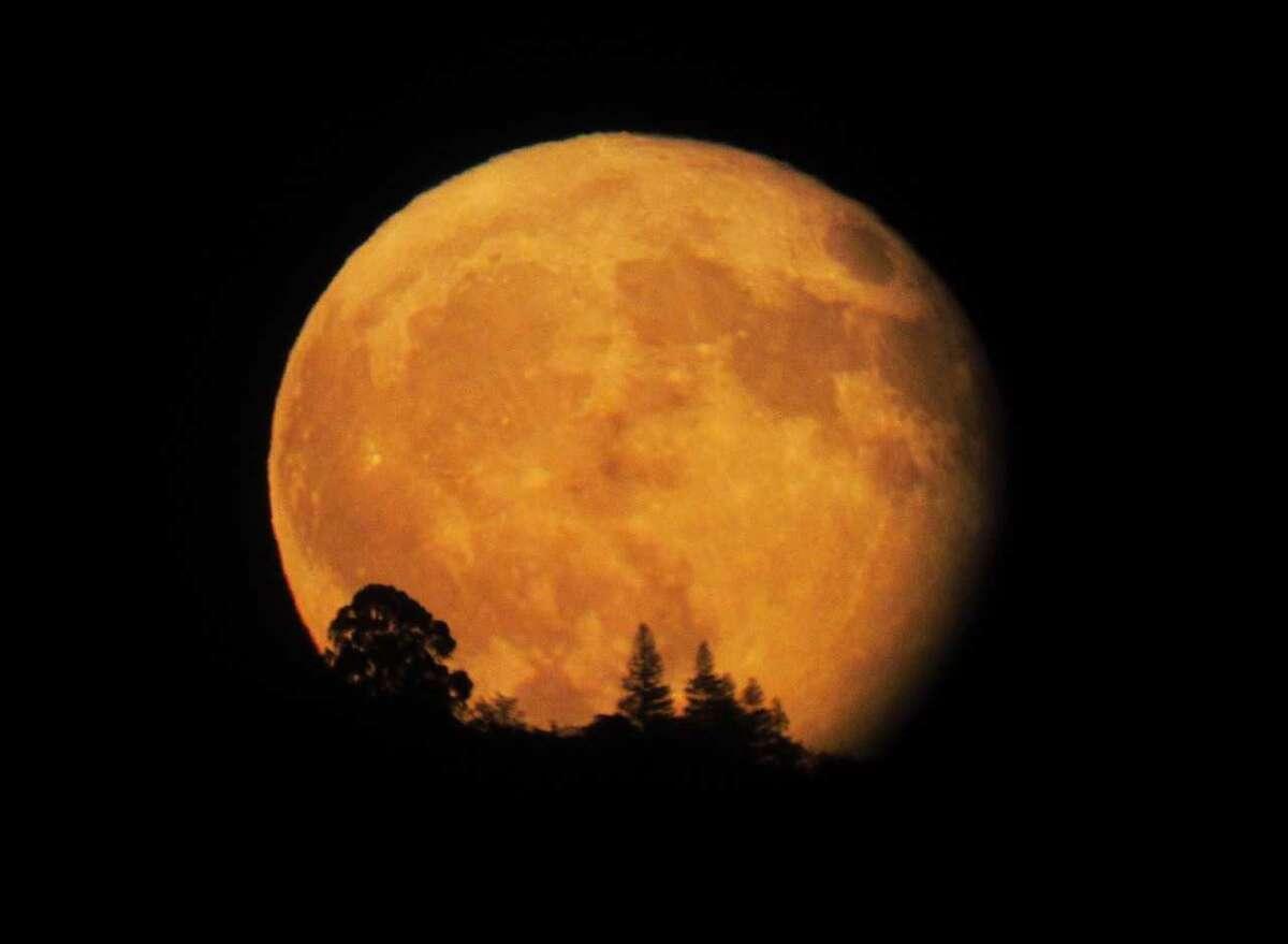 Stuart Gibson took a photo of the harvest moon as it rose above the El Dorado Hills through a telescope in Orangeville, California on October 5, 2017.