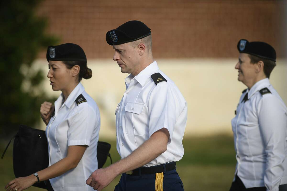 Army Sgt. Bowe Bergdahl, center, arrives with his legal team for a motions hearing on Wednesday, Sept. 27, 2017, in Fort Bragg, N.C. . Bergdahl faces court-martial on charges that he endangered comrades by walking off his post in Afghanistan in 2009. (Andrew Craft/The Fayetteville Observer via AP)
