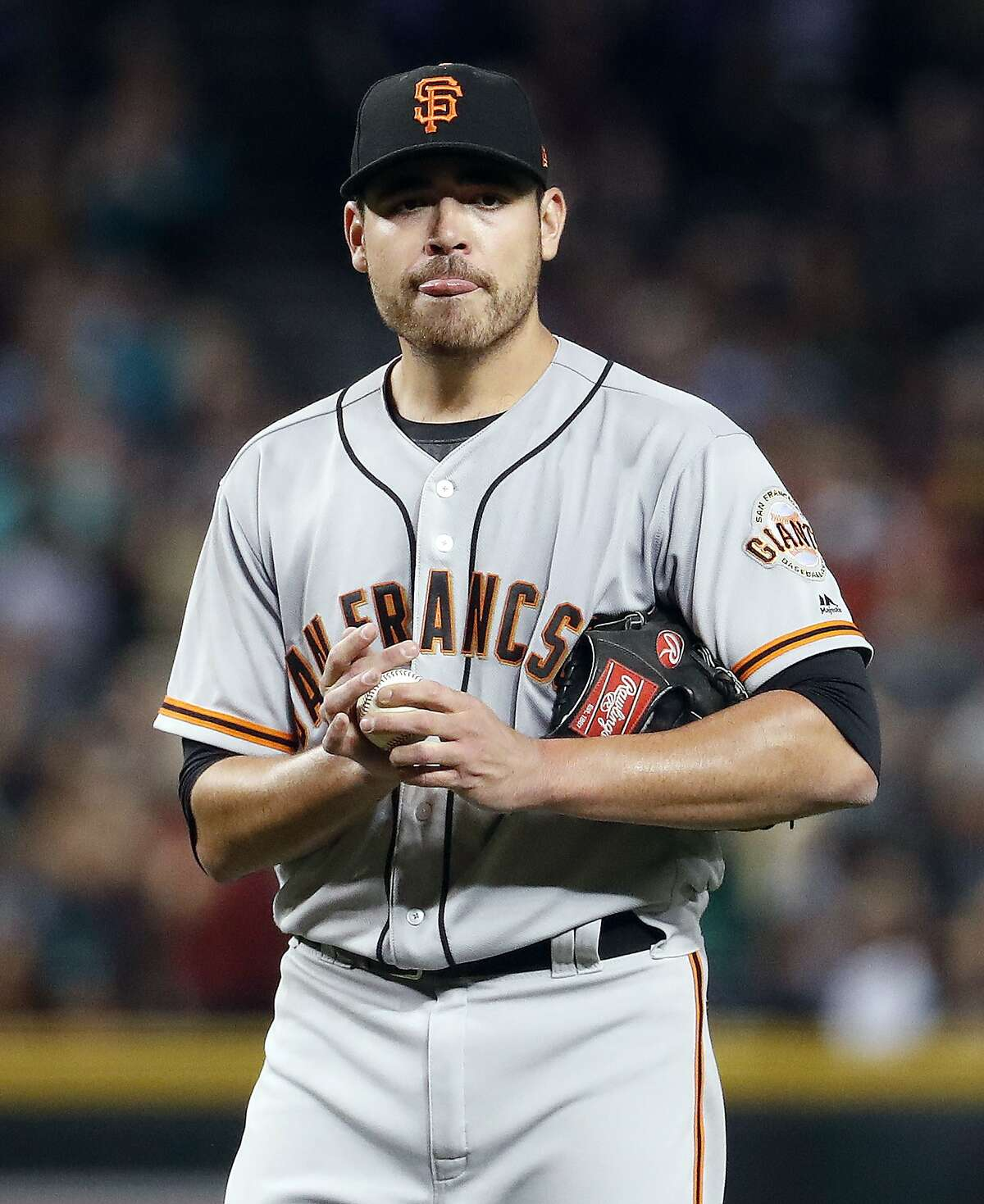 San Francisco Giants starting pitcher Matt Moore (45) looks to the dugout after giving up a grand slam against the Arizona Diamondbacks during the second inning of a baseball game, Tuesday, Sept. 26, 2017, in Phoenix. (AP Photo/Matt York)