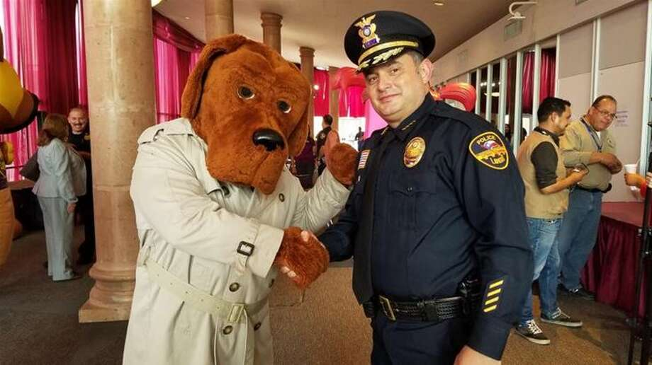 McGruff The Crime Dog and Laredo Police Chief Claudio Treviño Jr. pose for a photo during the announcement of the National Night Out, which is set for Oct. 10 at the grounds of the Laredo Independent School District Performing Arts Center. The event is free.  Photo: Cesar Rodriguez/Laredo Morning Times