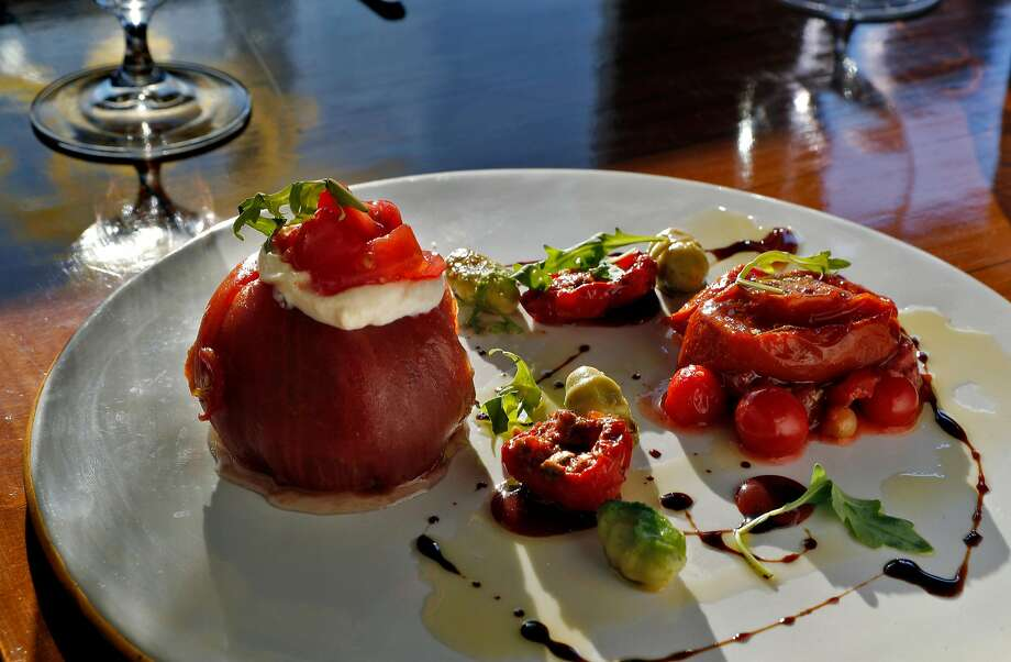 Heirloom tomato with pickled strawberry, brown butter ricotta and avocado at Perle in Oakland. Photo: Carlos Avila Gonzalez, The Chronicle
