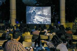 Laredoans watch a screening of Frankenstein Meets The Wolf Man on Friday night at the Villa Antigua Border Heritage Museum during it's movies on the patio night. The movie is the first of three screenings of classic horror films with the next movie set for October 14th, 2016.
