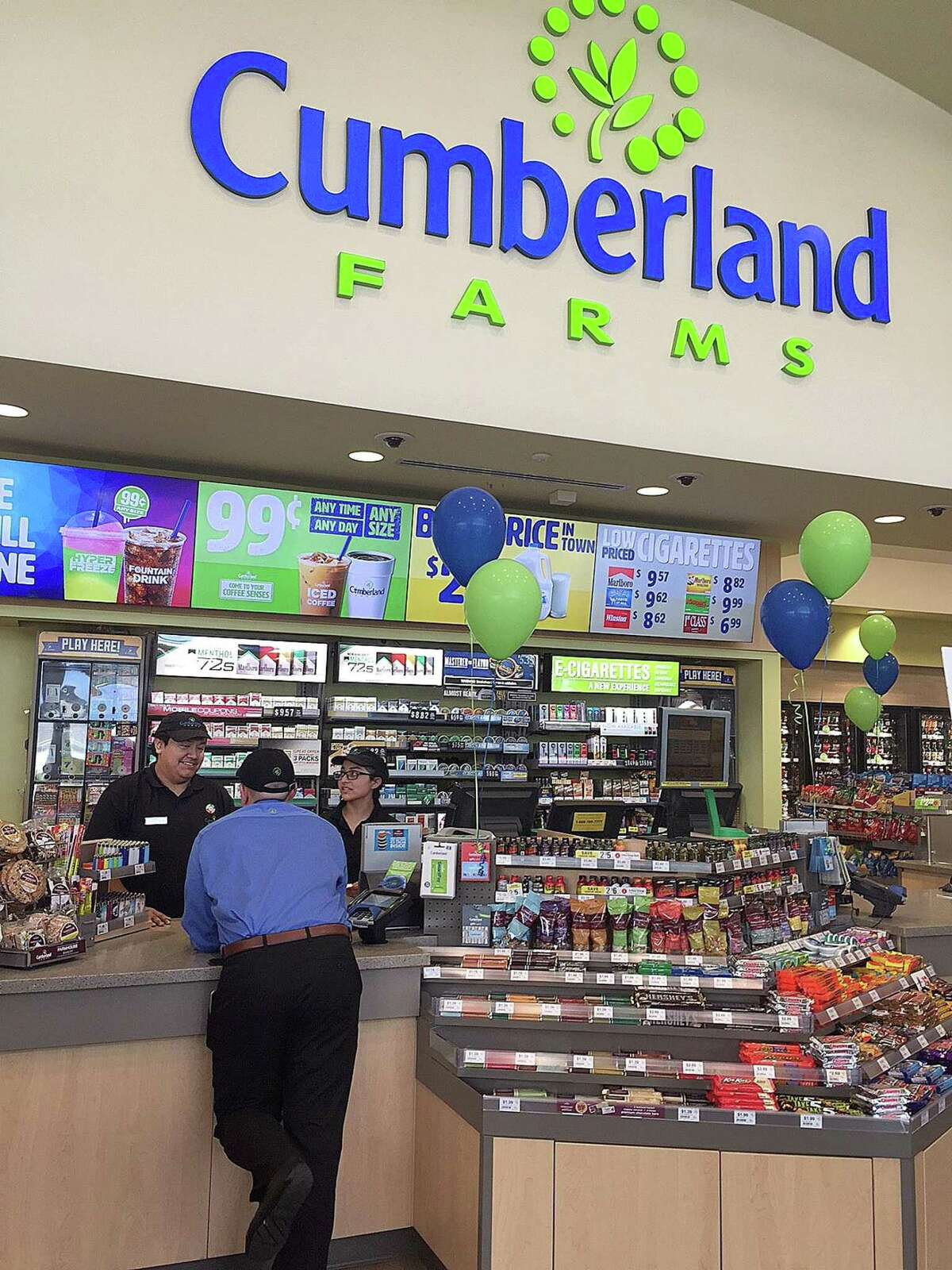 Cumberland Farms employees talk in the newly designed and built store in New Milford, Conn., on Thursday, Oct. 5, 2017.
