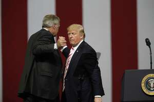 President Donald Trump shakes the hand of Sen. Luther Strange after he speaks at campaign rally on Sept. 22 in Alabama. Despite presidential support, Strange lost the Senate race to Roy Moore, a candidate far more Trumpian than Strange.