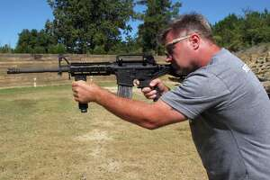 "Shooting instructor Frankie McRae aims a rifle fitted with a ""bump stock"" in Bunnlevel, N.C., on Wednesday. This is the kind of stock Las Vegas shooter Stephen Paddock used to simulate automatic fire. What can we expect Congress and the president to do about this? Nothing. Americans' only recourse is to change the balance of power in Washington."