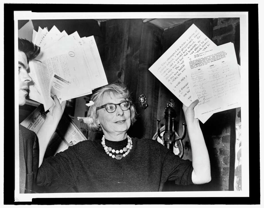 Jane Jacobs, as head of the Committee to Save the West Village, holds up documentary evidence at a press conference at in 1961, one of several battles she waged to preserve her neighborhood from redevelopment. A film festival that will examine her legacy and her influence on planning will be held at the Bijou Theatre in Bridgeport. Photo: Library Of Congress / Library Of Congress
