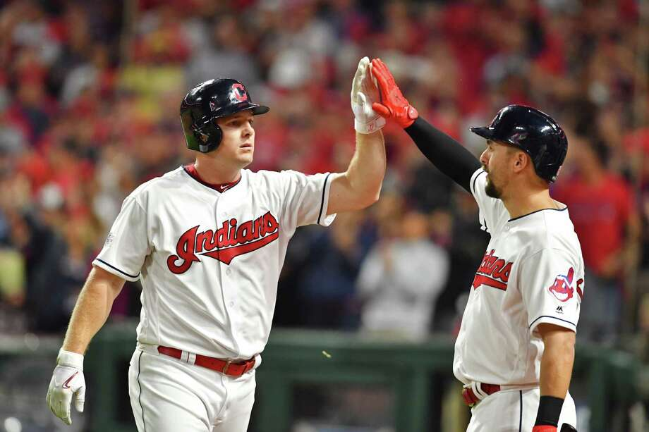 CLEVELAND, OH - OCTOBER 05:  Jay Bruce #32 is congratulated by his teammate Lonnie Chisenhall #8 of the Cleveland Indians after hitting a two-run home run during the fourth inning against the New York Yankees during game one of the American League Division Series at Progressive Field on October 5, 2017 in Cleveland, Ohio.  (Photo by Jason Miller/Getty Images) Photo: Jason Miller, Stringer / 2017 Getty Images