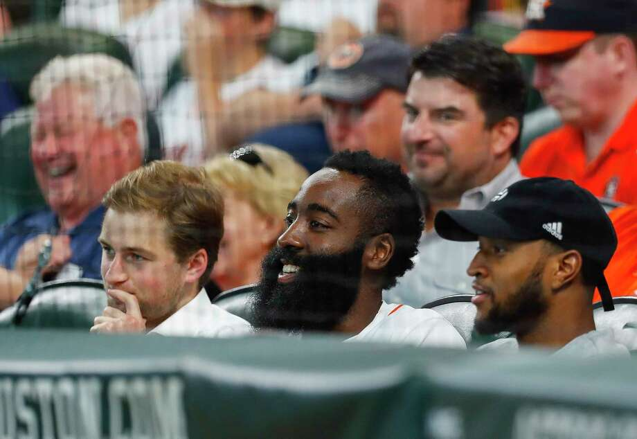Houston Rockets guard James Harden watches Game 2 of the ALDS with Patrick Fertitta (left) at Minute Maid Park on Friday, Oct. 6, 2017, in Houston.Browse through the photos for more photos of James Harden and Dallas Keuchel's glorious beards. Photo: Brett Coomer, Houston Chronicle / © 2017 Houston Chronicle