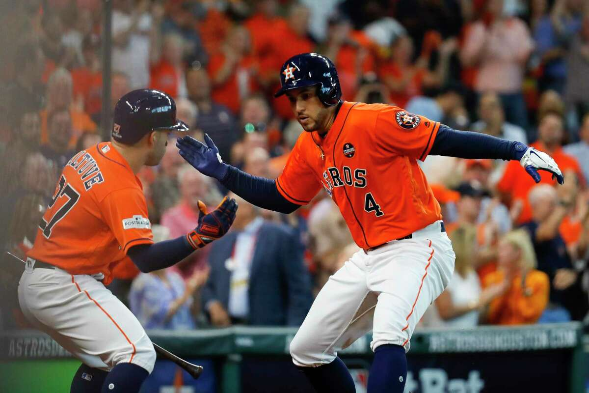 Houston Astros center fielder George Springer (4) celebrates his third inning home run during Game 2 of the ALDS at Minute Maid Park on Friday, Oct. 6, 2017, in Houston.
