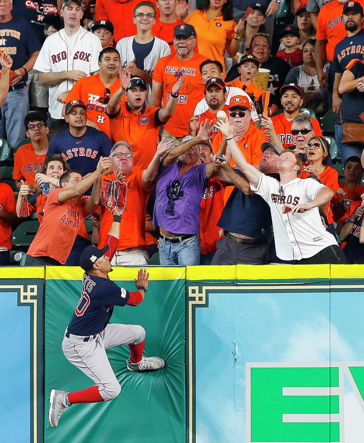 Boston Red Sox right fielder Mookie Betts (50) can't reach a third inning home run by Houston Astros center fielder George Springer (4) during Game 2 of the ALDS at Minute Maid Park on Friday, Oct. 6, 2017, in Houston.