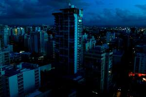 Blacked out buildings are seen in a tourist zone with lights only showing in buildings that have generators in San Juan, Puerto Rico on October 4, 2017.  US President Donald Trump asks Congress for a bumper $29 billion package of emergency relief after Hurricane Maria slammed into Puerto Rico. / AFP PHOTO / Ricardo ARDUENGORICARDO ARDUENGO/AFP/Getty Images