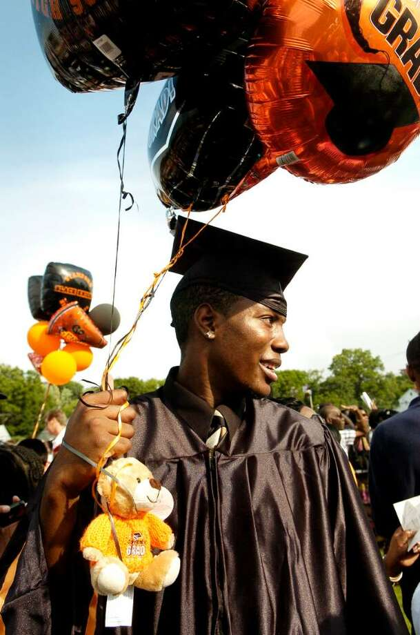 The class of 2010 graduates from Stamford High School on Thursday June 24, 2010 in Stamford, Conn. Mark Ellis holds the balloons his family gave him. Photo: Dru Nadler / Stamford Advocate
