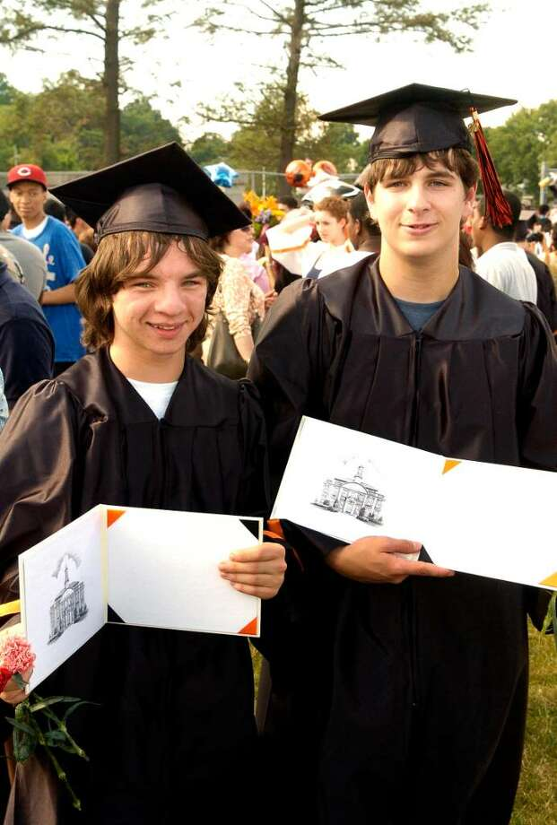 Michael Brokowski and Kevin Kallaway hold their diplomas. The class of 2010 graduates from Stamford High School on Thursday June 24, 2010 in Stamford, Conn. Photo: Dru Nadler / Stamford Advocate