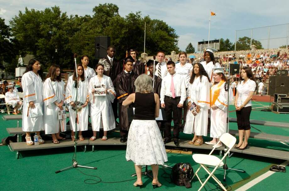 The SHS Concert Choir and Madrigal Singers  directed by Gloria Sinaguglia perform during Stamford High Graduation. The class of 2010 graduates from Stamford High School on Thursday June 24, 2010 in Stamford, Conn. Photo: Dru Nadler / Stamford Advocate