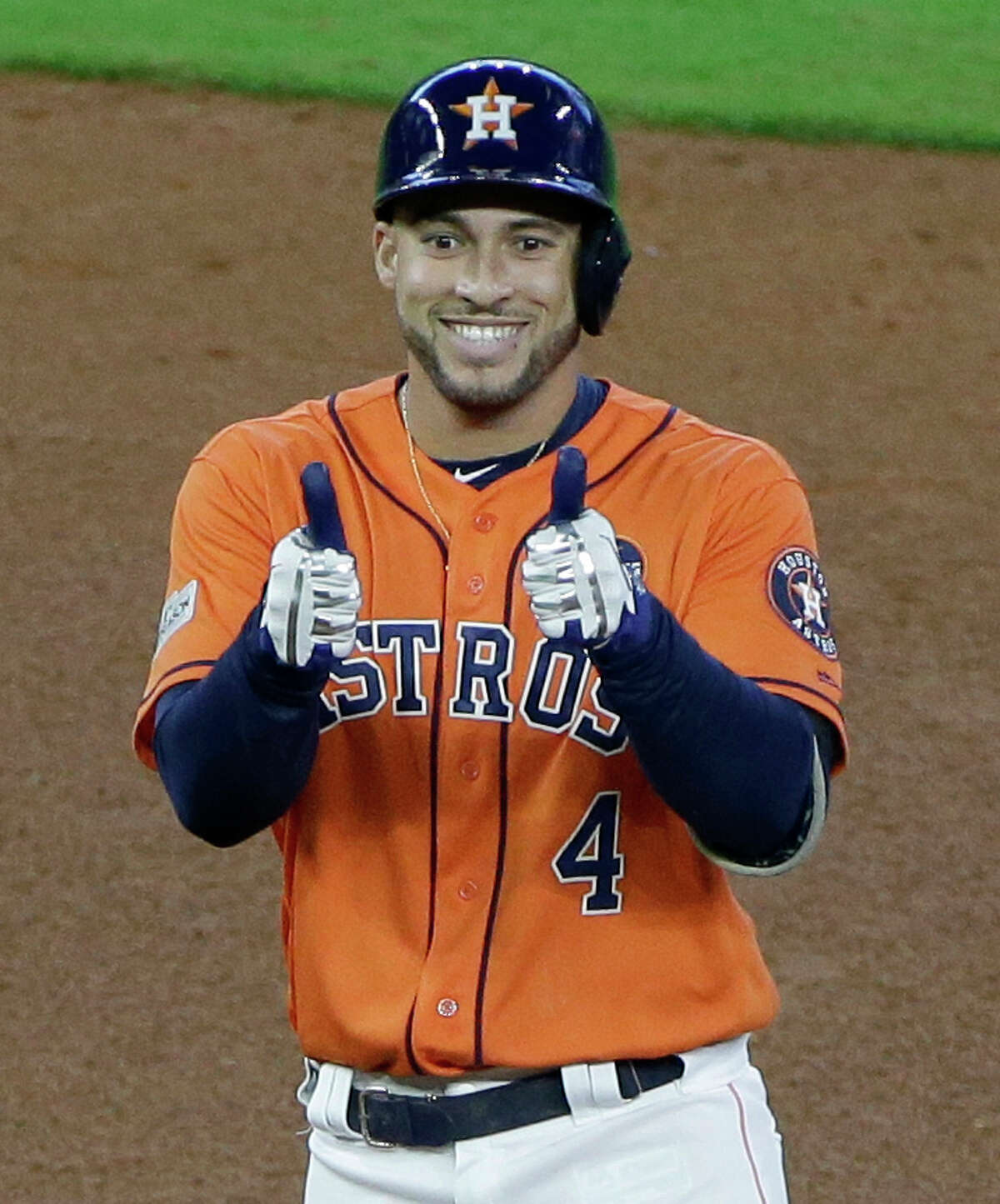 Houston Astros George Springer gives thumbs up as he stands on base after a double hit against the Boston Red Sox during fourth inning in Game 2 of the American League Division Series at Minute Maid Park Friday, Oct. 6, 2017, in Houston.