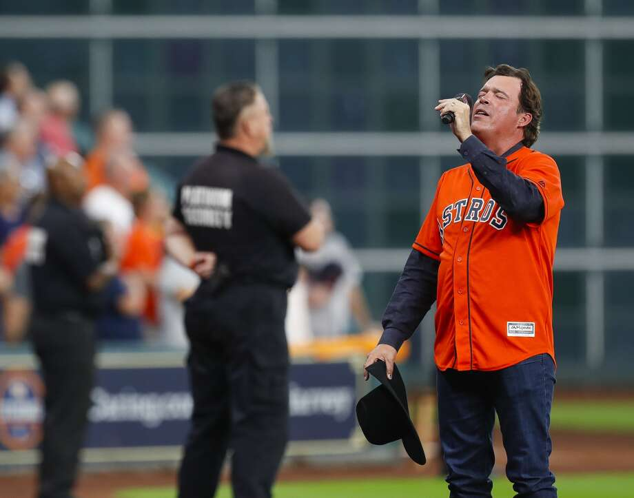 Clay Walker sings God Bless America during the seventh inning of Game 1 of the ALDS at Minute Maid Park on Thursday, Oct. 5, 2017, in Houston. ( Brett Coomer / Houston Chronicle )