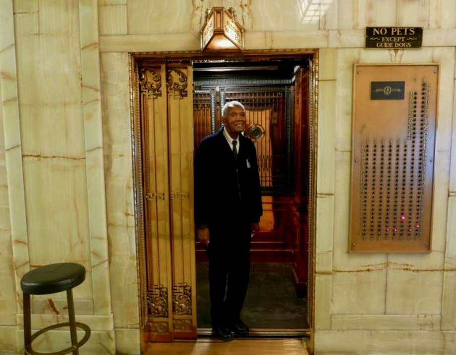 Hamilton Beale has operated an elevator at Smith Tower since 1999. He's leaving Seattle and moving back to the East Coast after automation takes over his job. (GeekWire Photo / Kurt Schlosser) Photo: GeekWire Photo / Kurt Schlosser