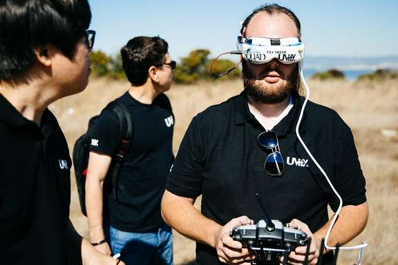 The Uvify team, Hyon Lim, Chief Executive Officer, and Robert Cheek, Head of Business Development, watch as Trevor Christensen, Drone Pilot, flies their product, Draco HD, in San Francisco, Calif. Thursday, October 5, 2017.