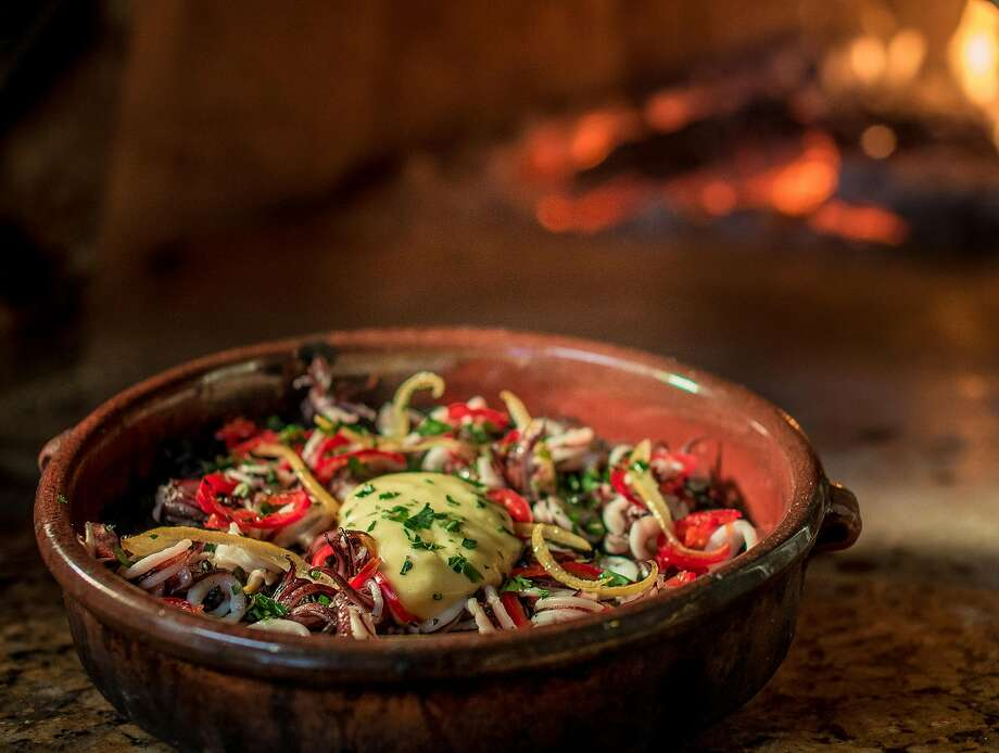 At Shakewell in Oakland: Squid ink bomba cooks in the wood-fired oven. Photo: John Storey, Special To The Chronicle