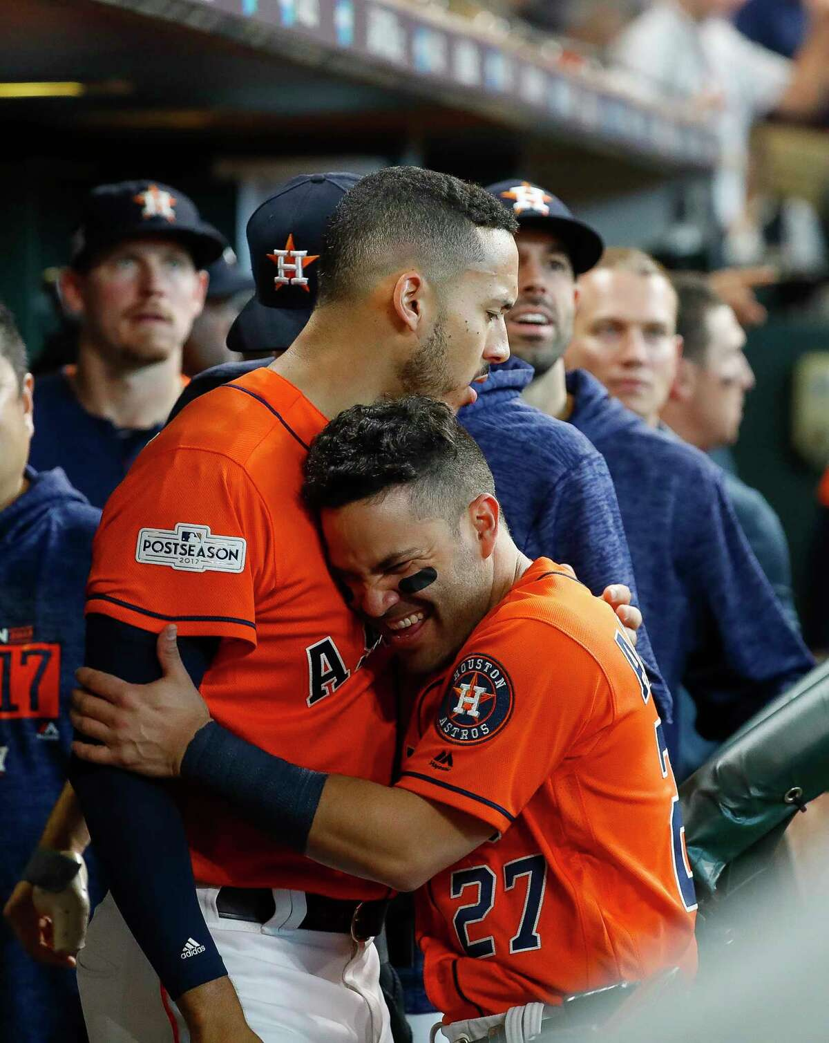 Houston Astros shortstop Carlos Correa (1) celebrates with second baseman Jose Altuve (27) after coming home on an Evan Gattis RBI single during the sixth inning of Game 2 of the ALDS at Minute Maid Park on Friday, Oct. 6, 2017, in Houston. Correa drove in two runs with a double before being driven in himself.