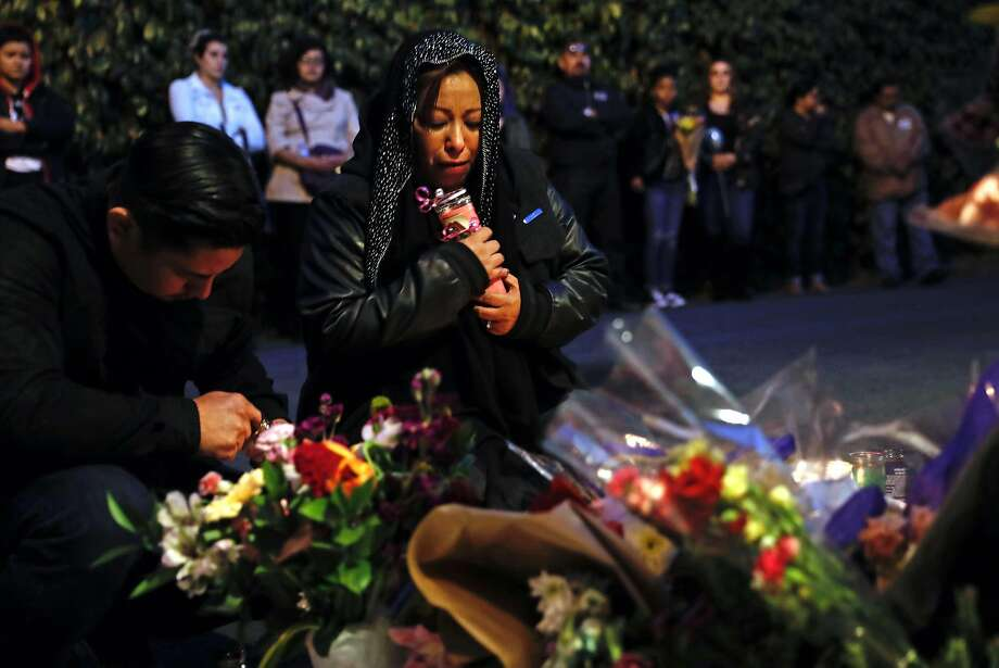 Susana Robles Desgarennes' mother, Sarai, holds a candle during a memorial vigil Thursday for the 20- year- old slain by her ex-boyfriend, Angel Raygoza, in a murder-suicide tied to domestic violence. Photo: Scott Strazzante, The Chronicle