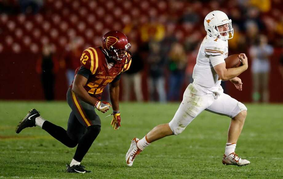 Texas quarterback Shane Buechele runs from Iowa State linebacker Marcel Spears Jr., left, during the second half of an NCAA college football game, Thursday, Sept. 28, 2017, in Ames, Iowa. Texas won 17-7. Photo: Charlie Neibergall /AP Photo