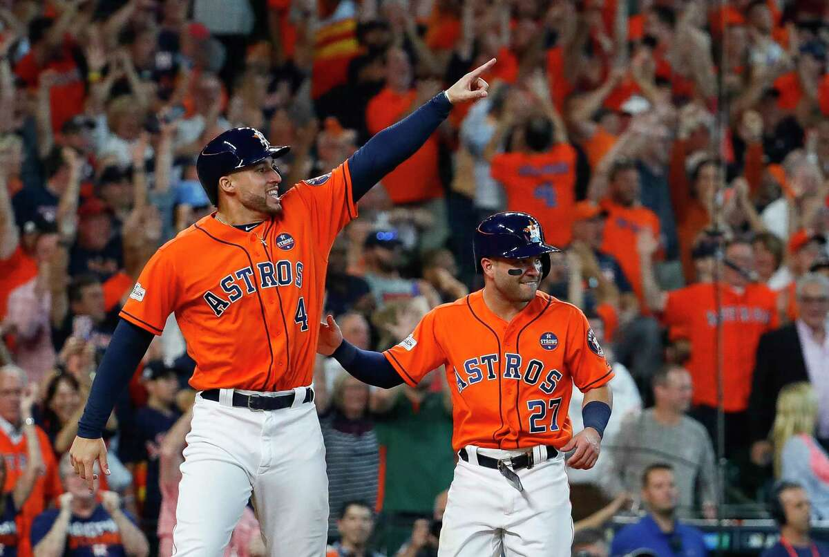 Houston Astros center fielder George Springer (4) points towards Carlos Correa at second base who had just drove in Springer and Altuve on a two-run double in the sixth inning of Game 2 of the ALDS at Minute Maid Park on Friday, Oct. 6, 2017, in Houston.
