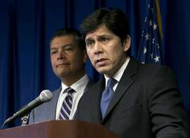 FILE -- In this Sept. 5, 2017 file photo, State Senate President Pro Tem Kevin de Leon, D-Los Angeles, right, flanked by Secretary of State Alex Padilla, answers questions at a news conference in Sacramento, Calif. California Gov. Jerry Brown signed de Leon's SB54, the statuary state bill, that extends protections statewide for immigrants living the United State illegally, Thursday, Oct. 5, 2017. (AP Photo/Rich Pedroncelli, file)