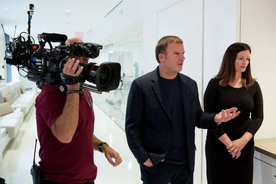 BILLION DOLLAR BUYER (2016 - 2018) Tilman Fertitta, left, and Kerri Carr work on a scene during a taping of Billion Dollar Buyer at the offices of Dancie Perugini Ware Public Relations on Monday, Oct. 2, 2017, in Houston. Photo: Brett Coomer, Staff / © 2017 Houston Chronicle