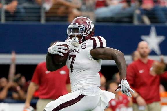 Texas A&M running back Keith Ford (7) sprints for the end zone during an NCAA college football game against Arkansas on Saturday, Sept. 23, 2017, in Arlington, Texas.